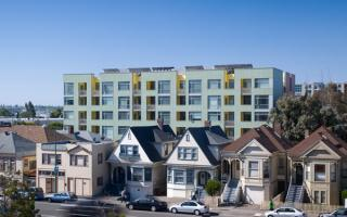 Merritt Crossing is a Green Point rated and LEED Platinum certified affordable housing building for seniors, a model of sustainable design in an urban area of Oakland in the Bay Area.
