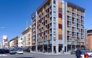 The Plaza Apartments in San Francisco was the first new permanent housing for formerly homeless residents; located in the South of Market neighborhood, the affordable housing complex achieves a sustainable goal of being certified LEED Silver and includes supportive services for residents.